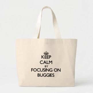 Mantenha a calma focalizando em carrinhos bolsas de lona