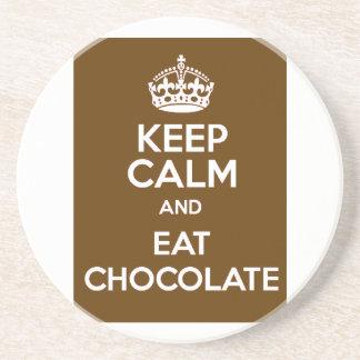 Mantenha calmo e coma o chocolate porta copos de arenito