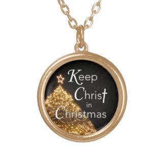Mantenha o cristo na árvore de w da colar do Natal