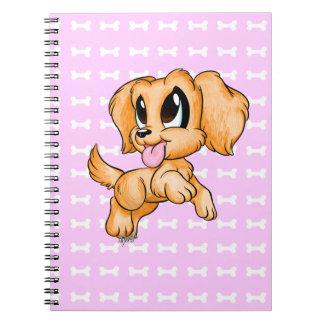 Mão bonito caderno tirado do rosa do cão do golden