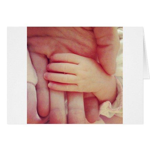 Mão infantil cartoes