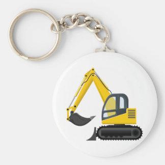 Máquina amarela e preta da construção da máquina chaveiro