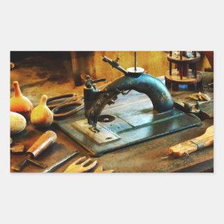 Máquina de costura antiquado adesivo retângular
