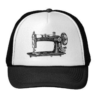 Máquina de costura do vintage boné