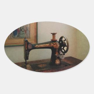 Máquina de costura e litografia adesivo oval