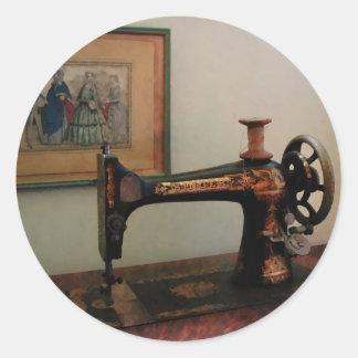 Máquina de costura e litografia adesivo