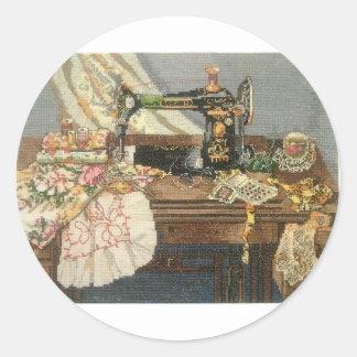 Máquina de costura e vestido adesivo