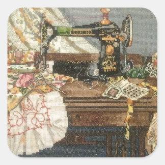 Máquina de costura e vestido adesivo quadrado