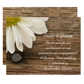 Margarida branca e anúncio de madeira do noivado