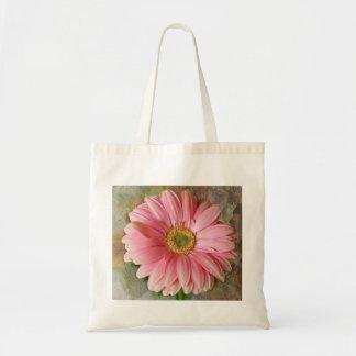 Margarida cor-de-rosa no bolsa do orçamento