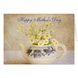 Margaridas em um cartão do dia das mães do bule