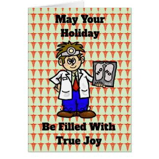 Médico com Ho Ho o cartão de Natal do raio X