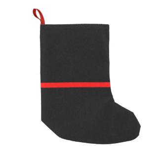 Meia De Natal Pequena A linha vermelha fina simbólica no preto contínuo