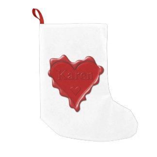 Meia De Natal Pequena Karen. Selo vermelho da cera do coração com Karen