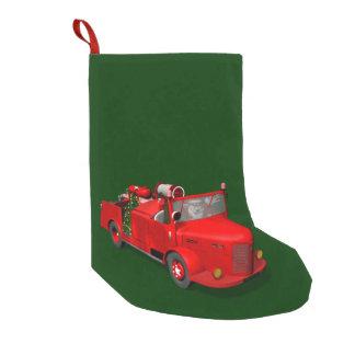 Meia De Natal Pequena Papai Noel doce na viatura de incêndio