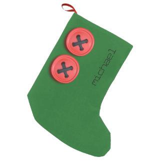 Meia De Natal Pequena Red Buttons na meia verde festiva do Natal