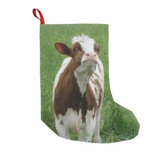 Meia De Natal Pequena Vaca de leite da leiteria na fazenda