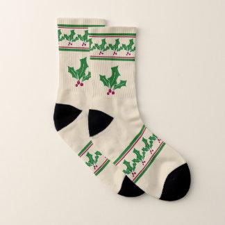 Meias Natal das bagas do azevinho, o vermelho e o verde