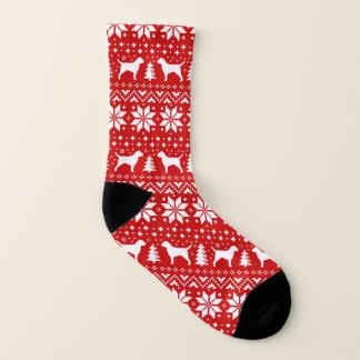 Meias Teste padrão vermelho do Natal das silhuetas de