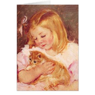 Menina com cartão do gato