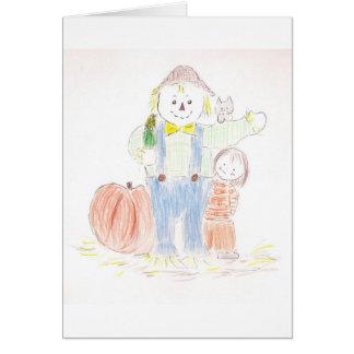 Menina com espantalho cartão
