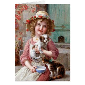 Menina com o cartão do filhote de cachorro e do