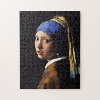 Menina com um quebra-cabeça do brinco da pérola