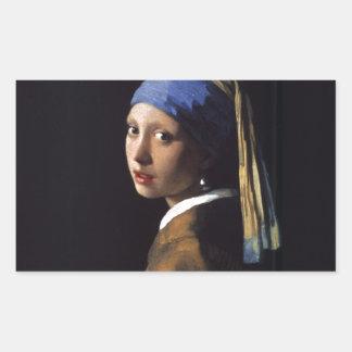 Menina com uma pintura do brinco da pérola por adesivo retangular