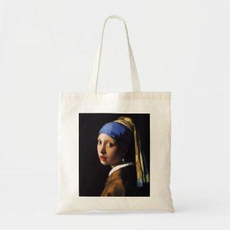 Menina com uma sacola do brinco da pérola bolsa para compra
