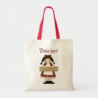 Menina do país com a sacola do professor da régua bolsa para compras