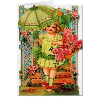 Menina do Victorian com o cartão de nota dos rosas