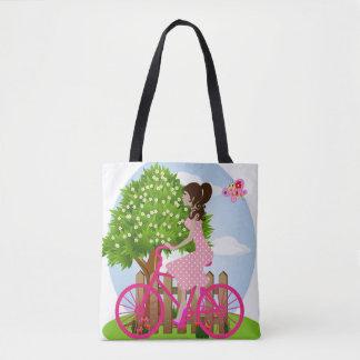 Menina em um bolsa da bicicleta (primavera)