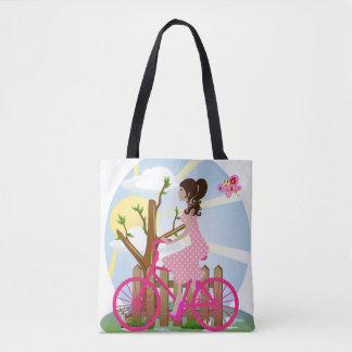 Menina em um bolsa da bicicleta (queda)