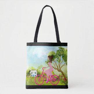 Menina em uma bicicleta - o bolsa