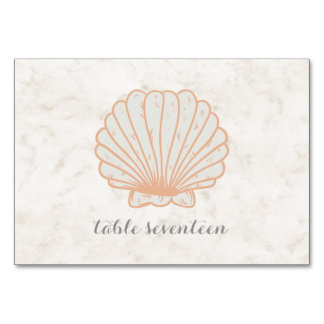 Mesa rústica alaranjada do casamento do Seashell