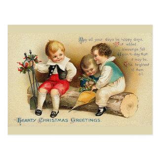 Miúdos bonitos do natal vintage cartão postal