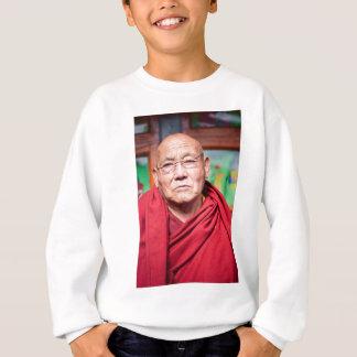 Monge budista na veste vermelha agasalho