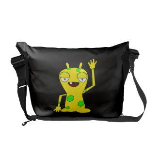 Monstro amarelo com os pontos verdes que acenam o  bolsas mensageiro