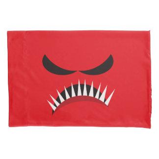 Monstro irritado com olhos maus e os dentes