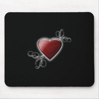 Mousepad Coração vermelho do amor que incandesce contra o