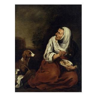 Mulher adulta com cão cartão postal