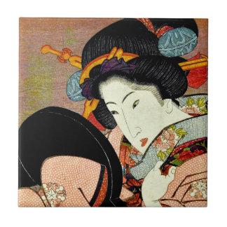 Mulher bonita no espelho por Utagawa Kunimaru