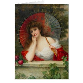 Mulher com cartão do parasol
