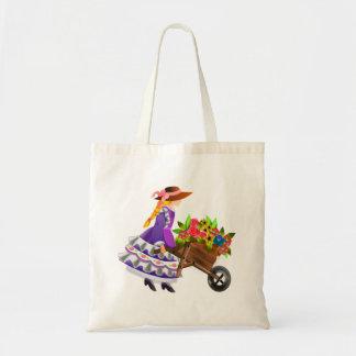 Mulher com o carrinho de mão das flores bolsas