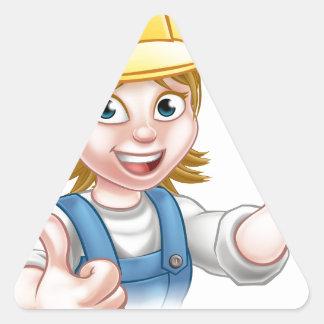 Mulher do mecânico ou do canalizador que guardara adesivo triangular
