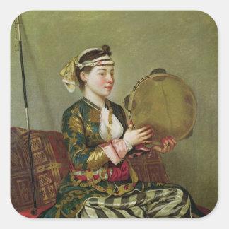 Mulher turca com um pandeiro adesivo quadrado