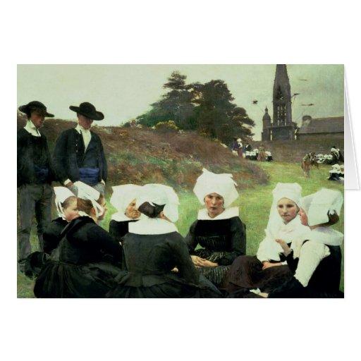 Mulheres bretãs que sentam-se em um perdão cartão