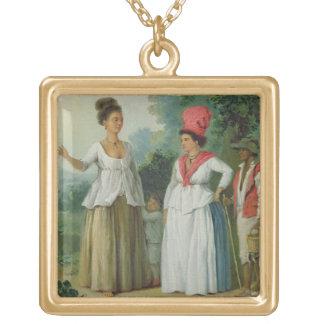 Mulheres indianas ocidentais da cor, com uma crian colar com pendente quadrado