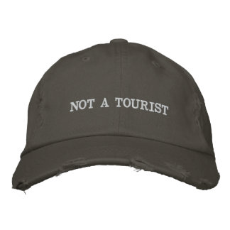 Não um boné afligido turista