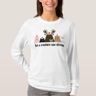 Não uma criatura agitava a camisa do Natal